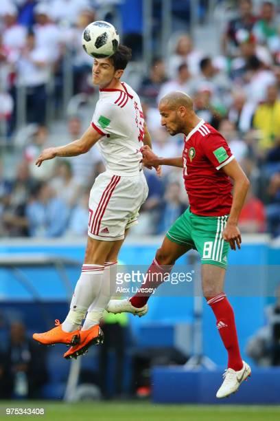 Sardar Azmoun of Iran wins a header from Karim El Ahmadi of Morocco during the 2018 FIFA World Cup Russia group B match between Morocco and Iran at...