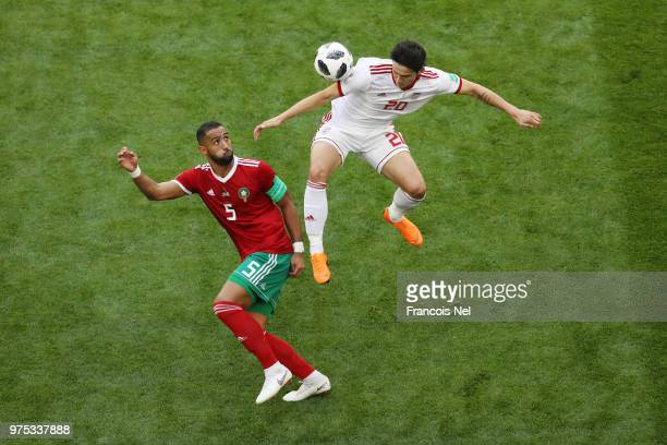 Sardar Azmoun of Iran wins a header from Mehdi Benatia of Morocco during the 2018 FIFA World Cup Russia group B match between Morocco and Iran at...