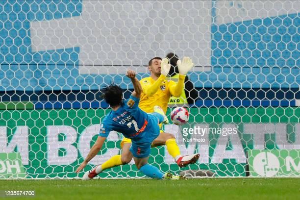 Sardar Azmoun of Zenit and Soslan Dzhanaev of Sochi in action during the Russian Premier League match between FC Zenit Saint Petersburg and FC Sochi...