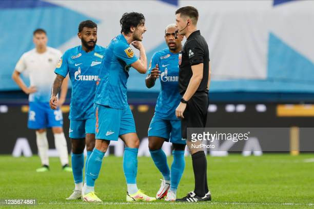 Sardar Azmoun of Zenit argues with referee Pavel Shadykhanov after being sent off during the Russian Premier League match between FC Zenit Saint...