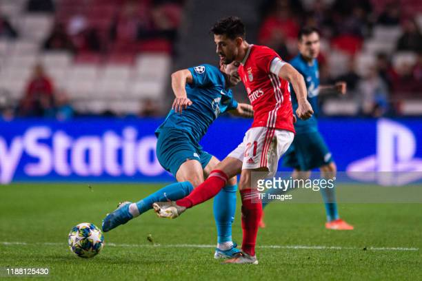 Sardar Azmoun of Zenit St Petersburg and Pizzi of SL Benfica battle for the ball during the UEFA Champions League group G match between SL Benfica...