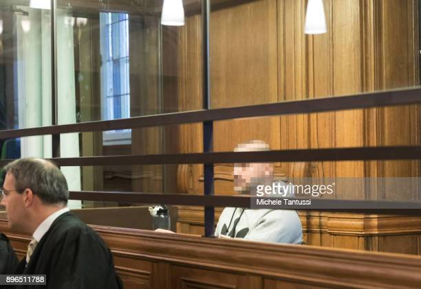 Sardar H a former member of a local chapter of the 'Hell's Angels' motorcycle club arrives for the first day of his murder trial at the Landgericht...