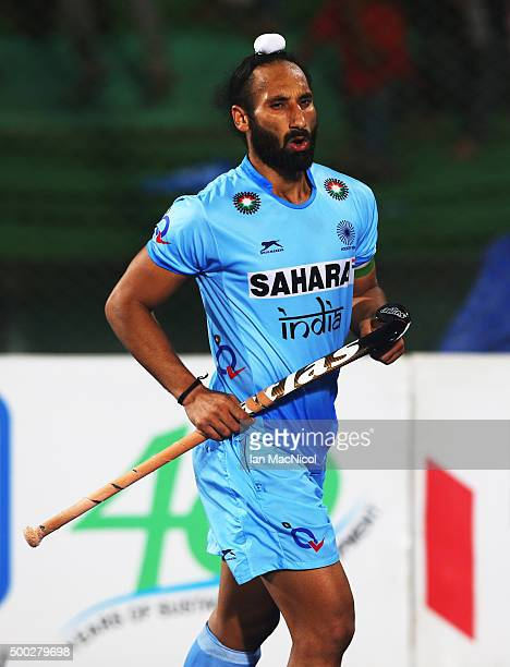 Sardar Singh captain of India celebrates scoring during the penalty shoot out during the match between Netherlands and India on day ten of The Hero...