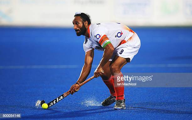 Sardar Singh captain of India controls the ball during the match between India and Belgium on day nine of The Hero Hockey League World Final at the...