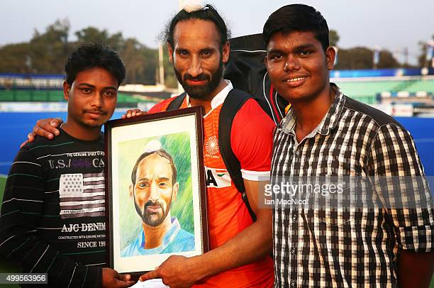 Sardar Singh captain of India is presented with a painting of himself prior to the match between Netherlands and Canada on day six of The Hero Hockey...