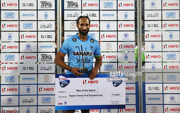 Sardar Singh captain of India poses with his man of the match award during the match between Australia and Belgium on day two of The Hero Hockey...