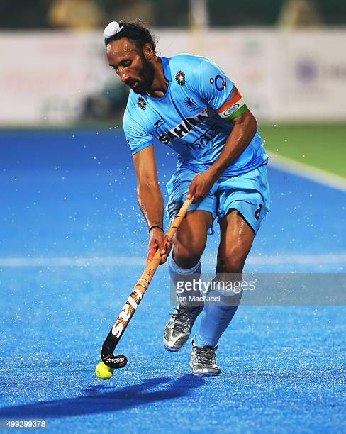 Sardar Singh captain of India runs with the ball during the match between Netherlands and India on day four of The Hero Hockey League World Final at...