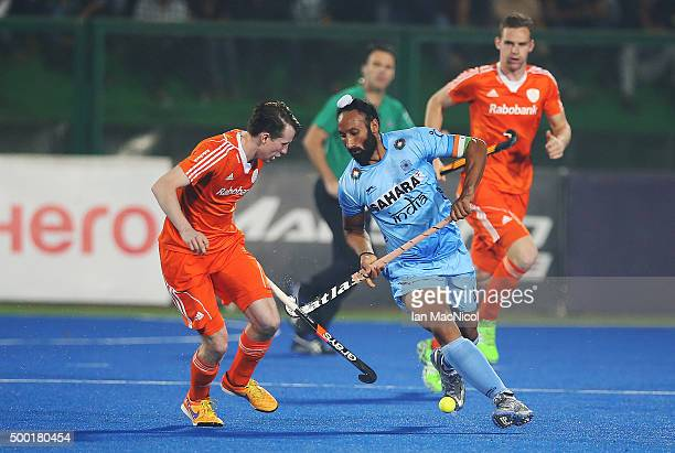 Sardar Singh captain of India runs with the ball during the match between Netherlands and India on day ten of The Hero Hockey League World Final at...