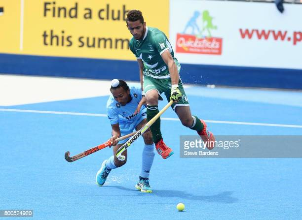 Sardar Singh of India and Ammad Shakeel of Pakistan battle for possession during the 5th8th place match between Pakistan and India on day eight of...