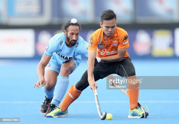 Sardar Singh of India and Azuan Hasan of Malaysia battle for possesion during the quarter final match between India and Malaysia on day seven of the...