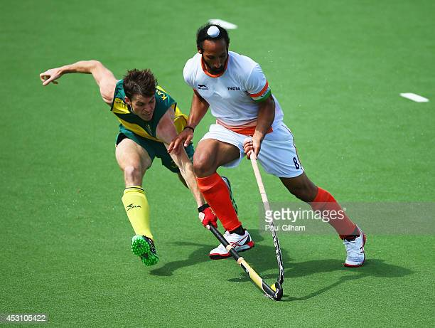 Sardar Singh of India battles with Fergus Kavanagh of Australia in the gold medal match between India and Australia at Glasgow National Hockey Centre...