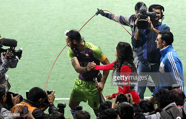 Sardar Singh with Actor Kajal Aggarwal and Akshay Kumar during Hockey India League match between Delhi Waveriders and Punjab Warriors at Major Dhyan...