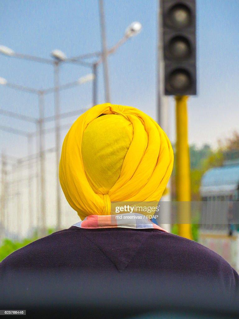 A sardar wearing yellow turban