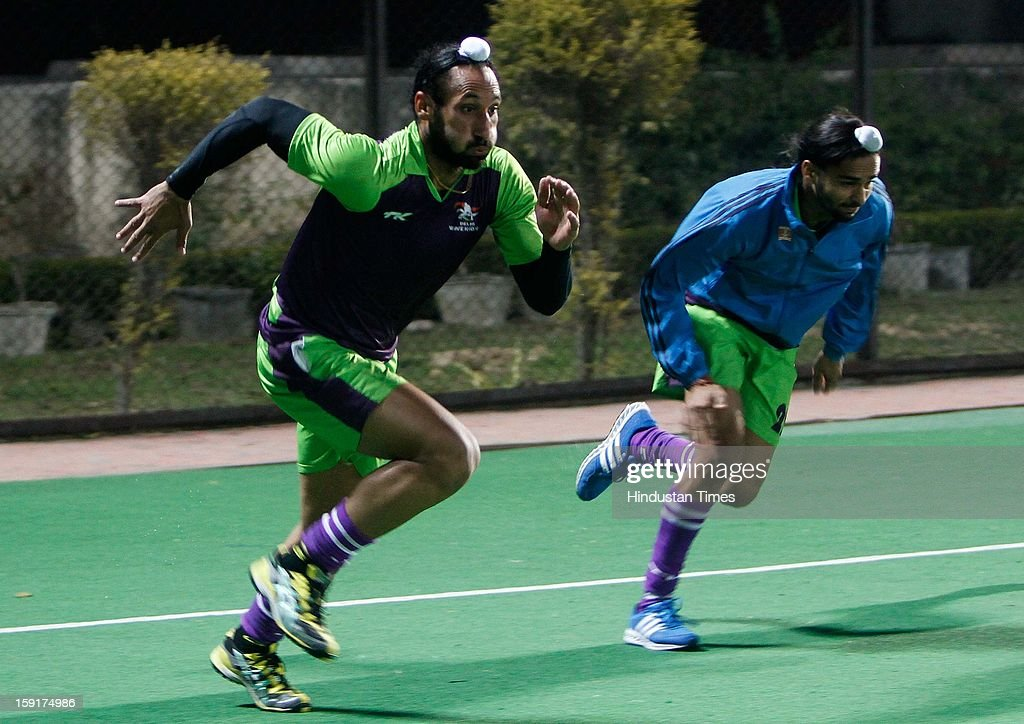 Sardar ( L) with team mates during practice session of Delhi Wave Riders hockey team for the upcoming Hockey India League at Major Dhyan Chand National Stadium on January 9, 2013 in New Delhi, India. Hockey India League is professional league for field hockey competition that will be played from 14 January to 10 February. There are 5 franchise teams consisting of players from India and around the world. The matches will be played on Home and away basis culminating into multi header playoffs.