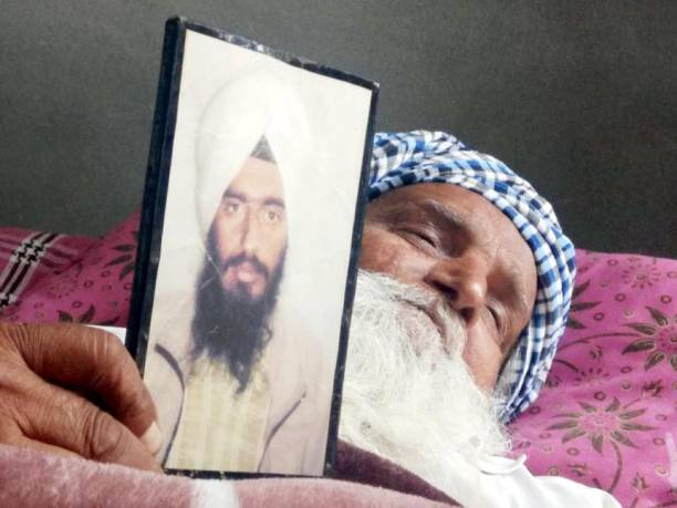 Sardara Singh grieving the death of her son Gurcharan Singh who was killed in Iraq at Jalal Usma Village on March 20 2018 near Amritsar India The 39..