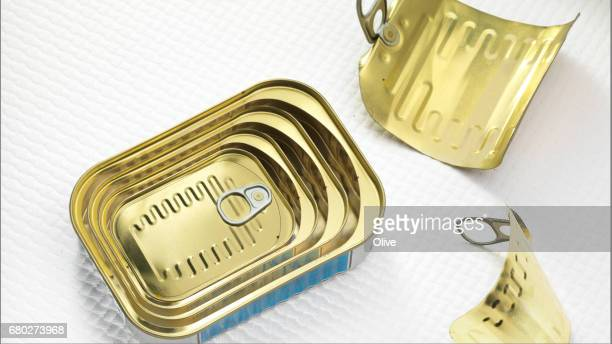 sardines in oil cans disposed as russian dolls - dolly golden stock pictures, royalty-free photos & images