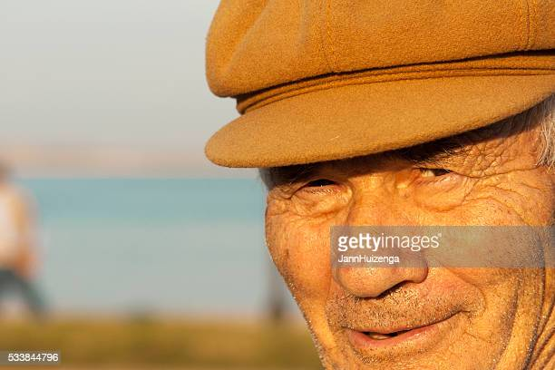 sardinia: fisherman in cap near sea at golden hour (close-up) - sardinia stock pictures, royalty-free photos & images