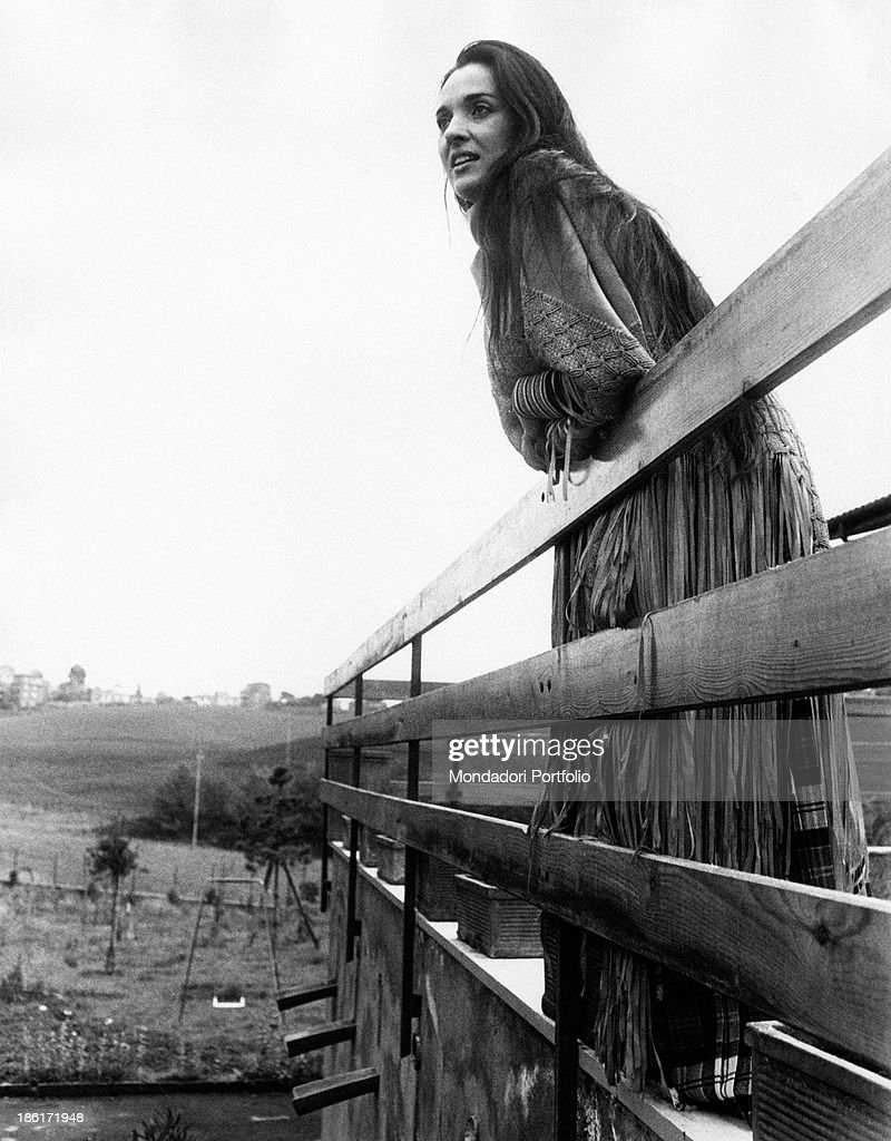 Charming Sardinian Singer Songwriter Maria Carta Poses Leaning Herself Against The  Wooden Balustrade Of A Terrace
