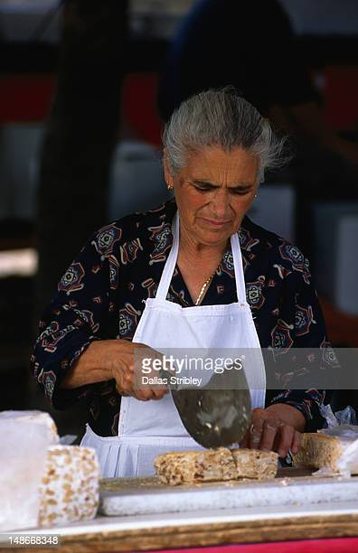 Sardinian woman selling torrone at the S'Ardia festival.