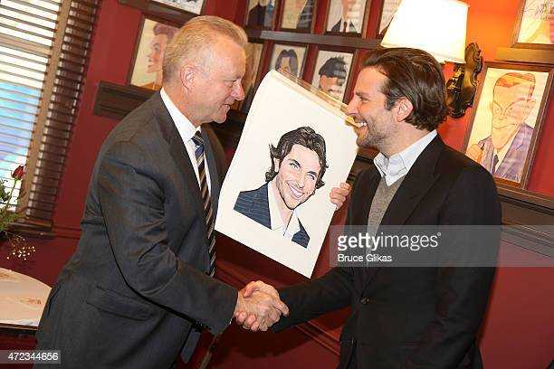 Sardis General Manager Max Klimavicius and Bradley Cooper pose as Cooper gets honored with a Sardi's Caricature in honor of his performance as John...