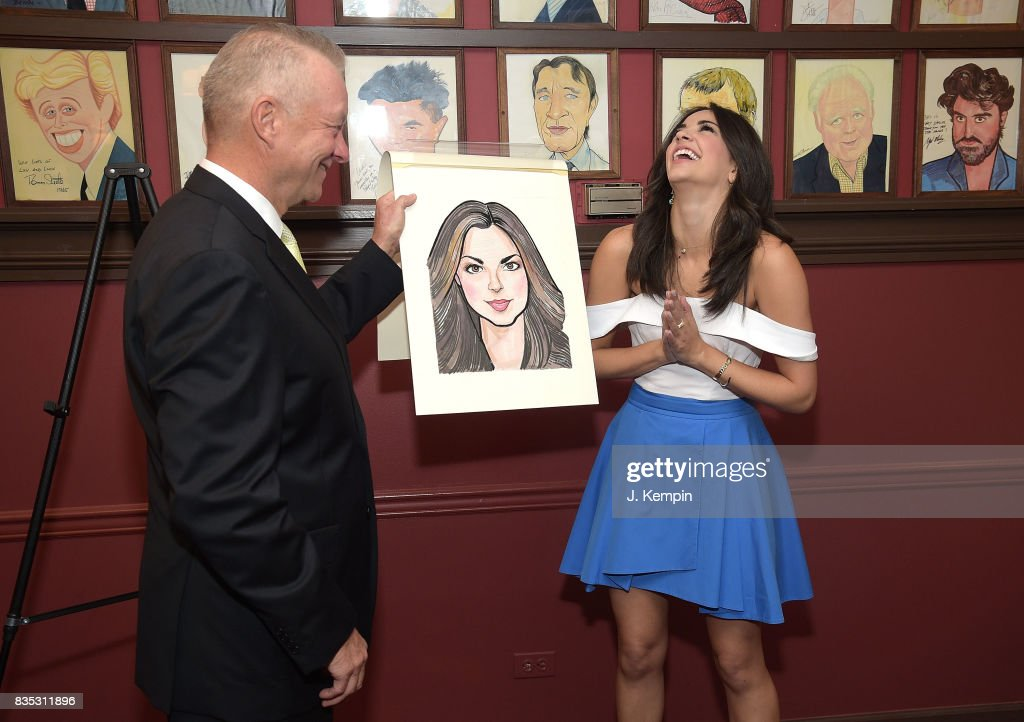 Sardi's owner Max Klimavicius and actress Ana Villafae attend her caricature unveiling at Sardi's on August 18, 2017 in New York City.