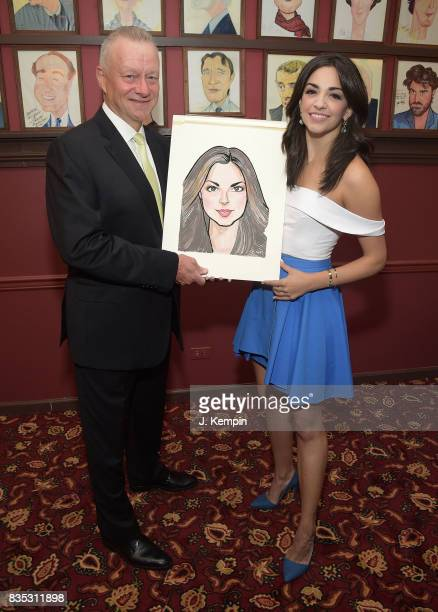 Sardi's owner Max Klimavicius and actress Ana Villafae attend her caricature unveiling at Sardi's on August 18 2017 in New York City