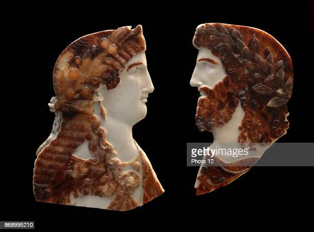 Sardonyx cameo busts of two members of the Roman Imperial family depicted as Jupiter Ammon and Juno or Isis About AD 3750 The woman resembles the...