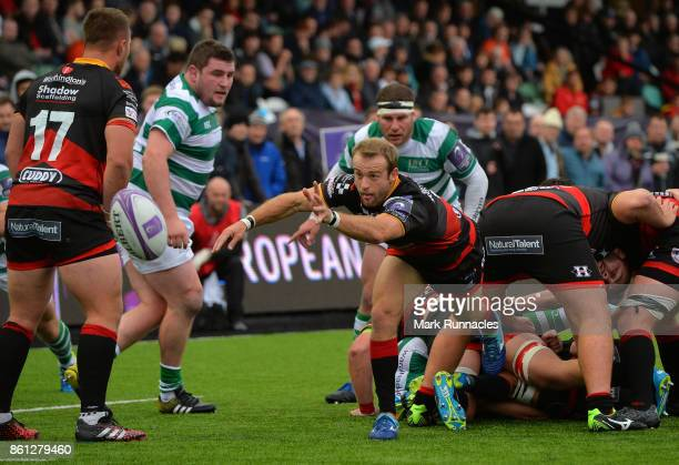 Sarel Pretorius of Dragons offloads the ball under pressure during the European Rugby Challenge Cup match between Newcastle Falcons and Dragons at...