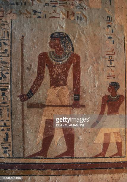Sarenput holding the reed and the Sekhem sceptre followed by his son Ankhu mural painting Tomb of Sarenput II Qubbet elHawa necropolis near Aswan...