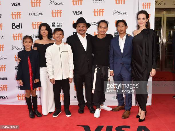 Sareum Srey Moch Loung Ung Kimhak Mun Rithy Panh Maddox JoliePitt Pax JoliePitt and Angelina Jolie attend the First They Killed My Father premiere...