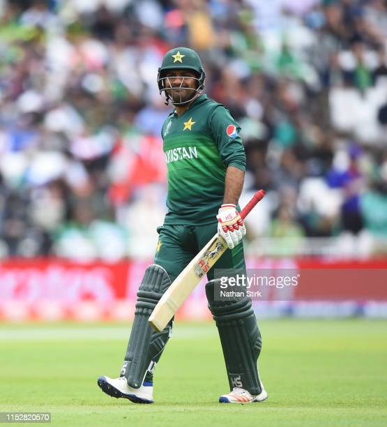 Sarfaraz Ahmed of Pakistan walks back to the pavilion after getting out during the Group Stage match of the ICC Cricket World Cup 2019 between West...