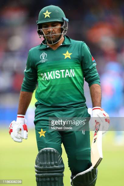 Sarfaraz Ahmed the captain of Pakistan walks off after being bowled by Vijay Shankar of India during the Group Stage match of the ICC Cricket World...