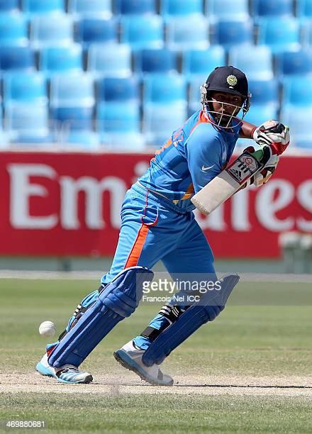 Sarfaraz Khan of India bats during the ICC U19 Cricket World Cup 2014 match between India and Scotland at the Dubai Sports City Cricket Stadium on...