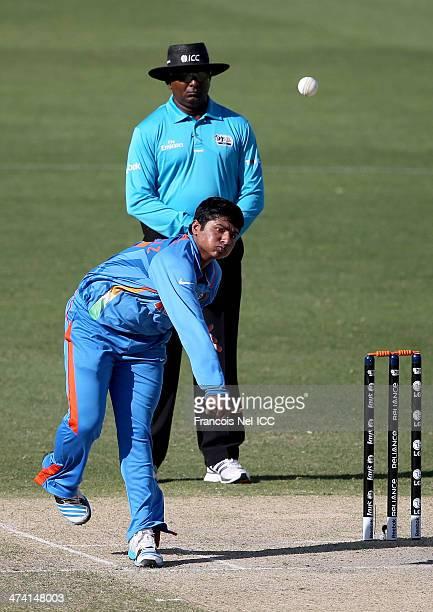 Sarfaraz Khan of India bowls during the ICC U19 Cricket World Cup 2014 Quarter Final match between England and India at the Dubai Sports City Cricket...