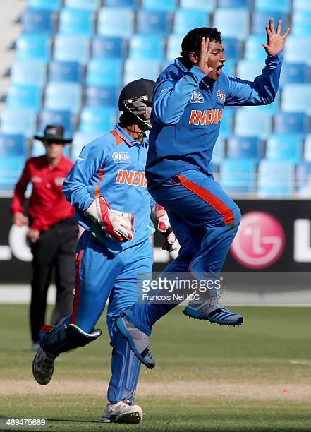 Sarfaraz Khan of India celebrate after dismissing Hassan Razza of Pakistan during the ICC U19 Cricket World Cup 2014 match between India and Pakistan...