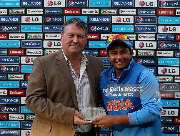Sarfaraz Khan of India is is awarded man of the match from David East CEO of Emirates Cricket Board after the ICC U19 Cricket World Cup 2014 match...