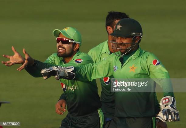 Sarfraz Ahmed and Babar Azam of Pakistan celebrate during the third One Day International match between Pakistan and Sri Lanka at Zayed Cricket...