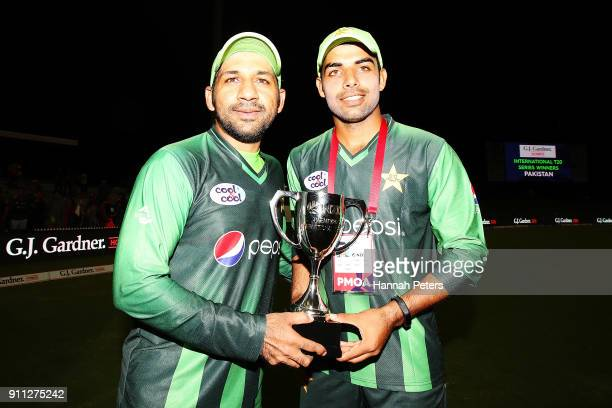 Sarfraz Ahmed and Shadab Khan of Pakistan celebrate after winning game three of the International Twenty20 match between New Zealand and Pakistan at...