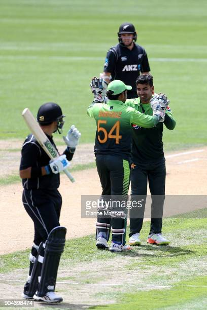 Sarfraz Ahmed and Shadab Khan of Pakistan celebrate the dismissal of Ross Taylor of New Zealand during the third game of the One Day International...