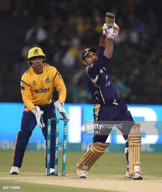 Sarfraz Ahmed from Quetta Gladiators views the ball after hitting against Peshawar Zalmi during the PSL T20 cricket match in the Gaddafi Stadium in...