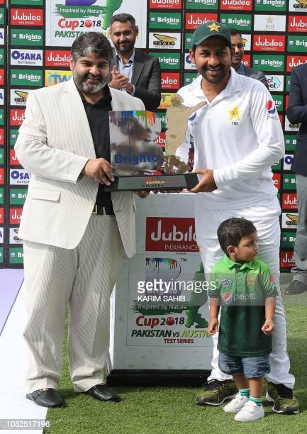 Sarfraz Ahmed of Pakistan and his son Mohammed Abdulla pose for a picture after the end of day four of the second Test cricket match between...