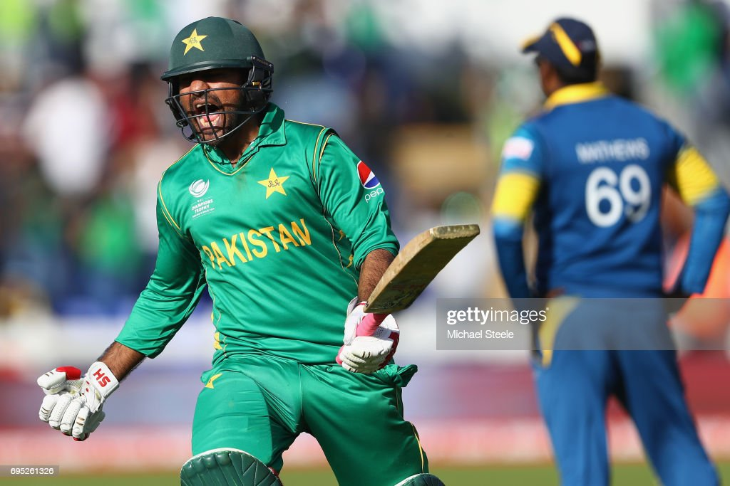 Sarfraz Ahmed of Pakistan celebrates hitting the winning runs and victory by 3 wickets as Sri Lanka captain Angelo Mathews (R) looks on during the ICC Champions Trophy match between Sri Lanka and Pakistan at the SWALEC Stadium on June 12, 2017 in Cardiff, Wales.
