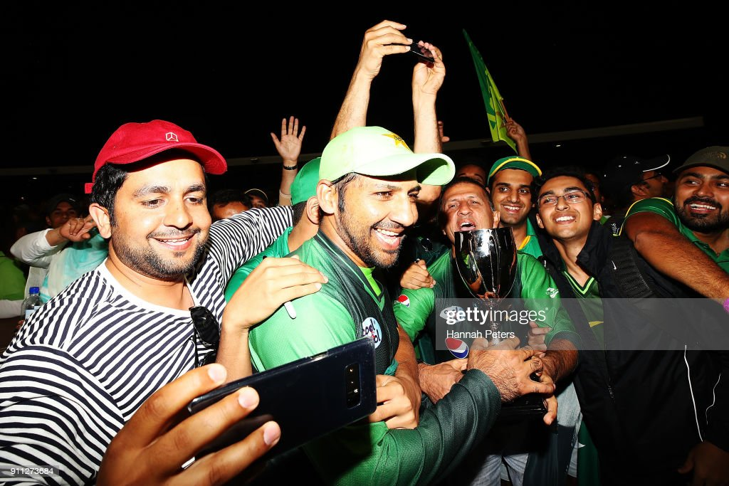 Sarfraz Ahmed of Pakistan celebrates with fans after winning game three of the International Twenty20 match between New Zealand and Pakistan at Bay Oval on January 28, 2018 in Mount Maunganui, New Zealand.