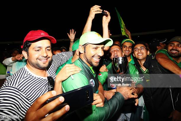 Sarfraz Ahmed of Pakistan celebrates with fans after winning game three of the International Twenty20 match between New Zealand and Pakistan at Bay...