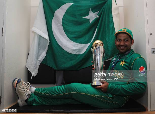 Sarfraz Ahmed of Pakistan celebrates with the ICC Champions Trophy after beating India during the ICC Champions Trophy Final between Pakistan and...