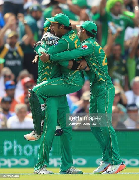 Sarfraz Ahmed of Pakistan congratulates Imad Wasim after catching MS Dhoni of India during the ICC Champions Trophy Final between Pakistan and India...
