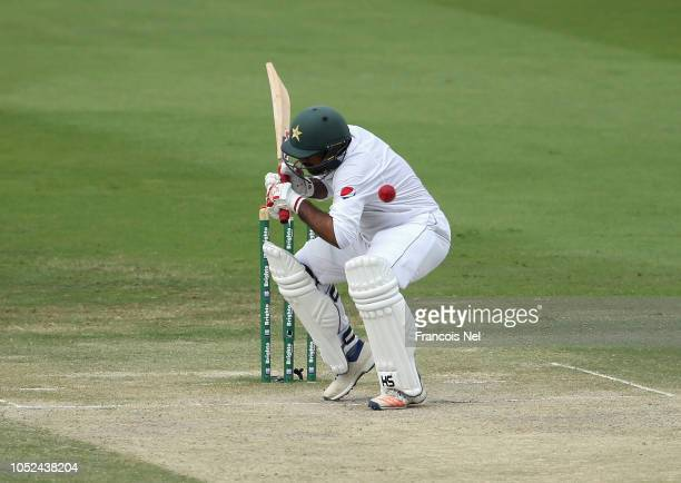 Sarfraz Ahmed of Pakistan is struck on the helmet by a short delivery during day three of the Second Test match between Australia and Pakistan at...
