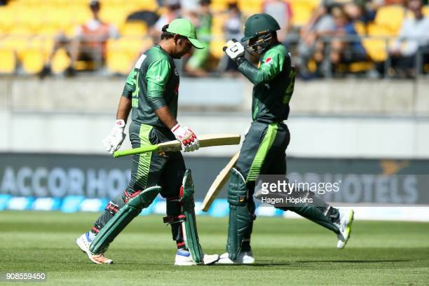 Sarfraz Ahmed of Pakistan leaves the field after being dismissed while Shadab Khan takes the fieldduring game one of the Twenty20 series between New...