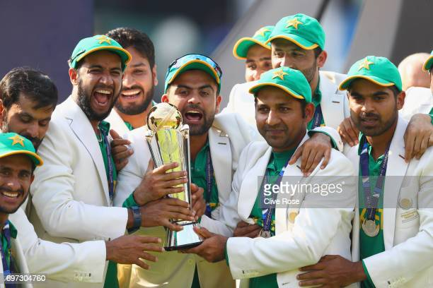 Sarfraz Ahmed of Pakistan lifts the winners trophy as Pakistan win the ICC Champions trophy cricket match between India and Pakistan at The Oval in...