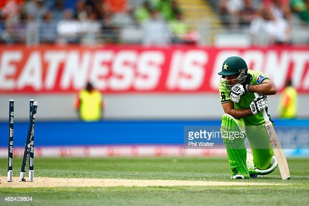 Sarfraz Ahmed of Pakistan looks dejected after being run out by Quinton de Kock of South Africa during the 2015 ICC Cricket World Cup match between...